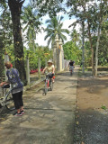 Helen and Stan on bikes with Janet beside hers on a trail  on an island near My Tho, Vietnam