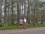 Ken and Jerry on a dirt back road next to a swamp in southwedstern Louisiana - when you gotta you gotta :-)