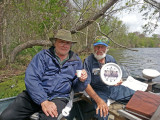 Norbert and Richard on Lake Martin. Norbert's clock shows only the number five meaning it's time to imbibe anytime.