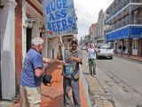Elliott contributing to a worthy cause in the French Quarter of New Orleans (Ken is in the background.)