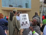 I Am A Man poster held by a spectator at the reopening ceremony of the National Civil Rights Museum at the Lorraine Motel
