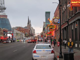 Broadway with the Bridgestone Arena on the left in downtown Nashville, Tennessee