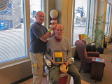 Elliott graciously provides Ken with a superb figurative haircut - at the Barbershop Harmony Society headquarters in Nashville