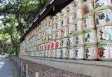 Sake barrels (kazaridaru) on the gravel road entrance to the Meiji Shrine - Tokyo