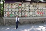 Judy in front of the sake barrels (kazaridaru) on the gravel road entrance to the Meiji Shrine - Tokyo
