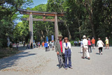 Judy and Richard at the majestic torii located along the forested approach to  the Meiji Shrine complex - Tokyo