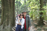 Judy and Richard on the gravel road to the Meiji Shrine complex surrounded by cedars.