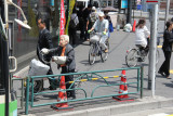 Bicyclists in Akihabara (Electric Town) - district in central Tokyo famous for its electronic, manga and anime shops