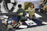 Judy receiving a lesson in calligraphy from Masunaga Koshun in her Tokyo studio