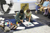 Judy creating a calligraphy painting with the help of Masunaga Koshun - Judy chose a butterfly theme for the painting