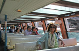 Judy on a water bus on the Sumida River