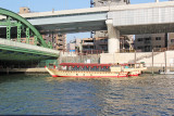 A boat available for rent, perhaps for dinner parties, is near the UmayaBashi Bridge on the Sumida River