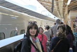 Judy at the Tokyo Station ready to board the Shinkansen 700 bullet train (on the left) to Odawara