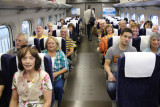 Judy with a rowdy but happy group on the Shinkansen 700 bullet train going from Tokyo Station to Odawara