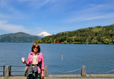 Judy at the Moto-Hakone port with Mt. Fuji, the red torii gate of the Hakone Shrine and Lake Ashi in the background