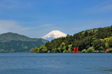 Mt. Fuji, the red torii (gate) of the Hakone Shrine and Lake Ashi as seen from Moto-Hokane