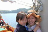 Mother and child aboard a cartoonish pirate ship on Lake Ashi going from Moto-Hakone to Togendai.
