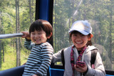 Two kids on the Hakone Ropeway from Togendai to the Ubako Station and then to Owakudani