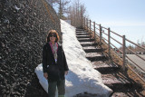 Judy with snow at the stairs of a hiking trail on Mt. Fuji - at the Fuji Subaru Line 5th Station