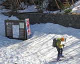 A skier (perhaps an official?) who just finished exploring Mt. Fuji - at the Fuji Subaru Line 5th Station