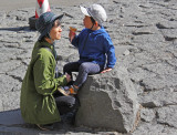 A mother and her child at the Fuji Subaru Line 5th Station - more than halfway up the side of Mt. Fuji