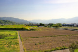 Farmland and mountains as seen while traveling from Owakudani to Suwa-shi