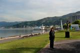 Judy near Lake Suwa with a cartoonish swan boat in the background - in Suwa-shi
