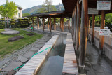 Public hot springs for the feet - people sit on the stones and put their feet in the water - near Lake Suwa in Suwa-shi