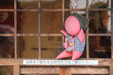 A sarubobo (a symbol of Takayama) hanging at Takayama Jinya in Old Town, Takayama