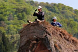 Close-up of workers repairing the thatched roof of a Gassho style house in the Gassho-zukuri Village in Shirakawa-go
