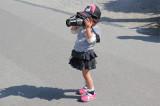 A little girl using a big camera in the Gassho-zukuri Village in Shirakawa-go tucked away in the surrounding mountains
