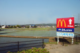 Weird juxtaposition of a McD's sign with traditional rice paddies - while traveling from the village at Shirakawa-go to Kanazawa