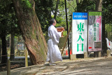 A monk going to an Omiyamairi (newborn celebration) which we witnessed but were not allowed to photograph at Kasuga Taisha, Nara