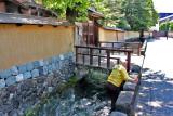 Man retrieving an object from the Onosho Canal - seen as we entered the Naga-machi Samurai District in Kanazawa