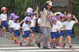 A teacher with her students leaving the Kenroku-en Garden in Kanazawa