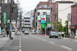 The large green awning on the right side of the street marks the entrance to the indoor Omi-cho Market in Kanazawa
