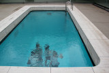 Judy (far right) appears to be waving under water in the Swimming Pool by Leandro Erlich - at the Contemporary Art Museum