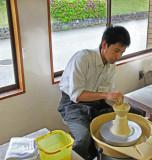 An artist creating a bowl at the Nomi Kutani Ceramics Center in the Kutani Pottery Village in Nomi-shi