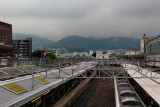 The main train station in Kyoto. We arrived here from Komatsu. Kyoto and surrounding mountains are in the background.