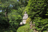 A Buddhist stone statue at the Ryoanji Temple in Kyoto