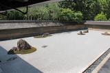 "The Kare-sansui (Dry Landscape) Rock Garden or ""Zen Garden"" at the Ryoanji Temple in Kyoto"