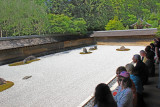 """Judy after meditating (yoga?) at the Kare-sansui (Dry Landscape) Rock Garden or """"Zen Garden"""" at the Ryoanji Temple"""