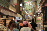 Judy (pink hat) with Sallie and John in front of her at the busy Nishiki Market in Kyoto