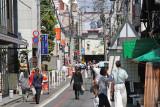 Nishiki-dori (street) - a white awning is at the entrance of the covered Nishiki Market at Takakura-dori in Kyoto