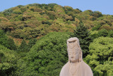 Top of the statue of Bodhisattva Avalokitesvara at the Ryozen Kannon War Memorial - Higashiyama Mountains in the background