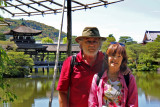 Judy and Richard near the roofed bridge over a pond at the garden of the Heian-jingu Shrine in Kyoto