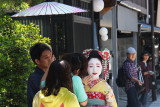 This woman appears to be a Maiko (apprentice Geiko) but may have been a tourist - in the Gion (Geisha/Geiko) District of Kyoto