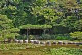 Stepping-stone path (Garyu-kyo  - lying dragon bridge) in a pond at the Heian-jingu Shrine in Kyoto