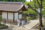 Two monks in the Kasuga Taisha complex (a Shinto shrine)  in Nara Park in Nara