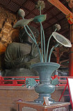 Massive, metal lotus vase and butterflies in front of the Great Buddha in Todai-ji Temple's Main Hall in Nara Park in Nara